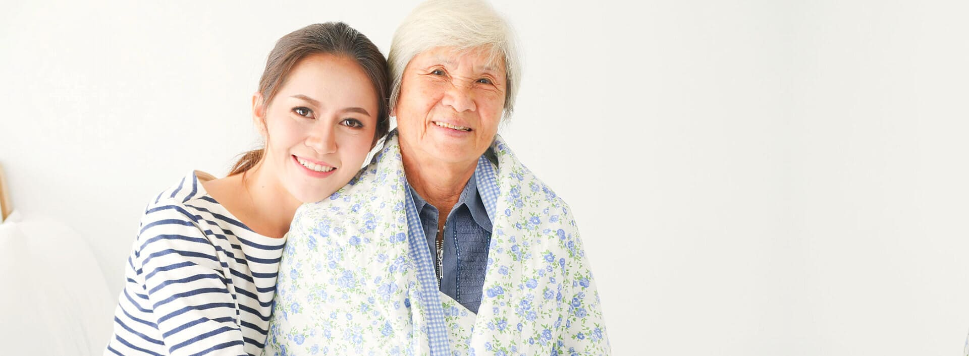 portrait of caregiver and senior woman smiling